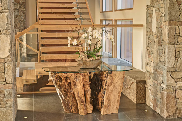 Custom stump console table with glass top.
